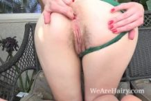 Cassidy Blessing drains outdoors on her chair