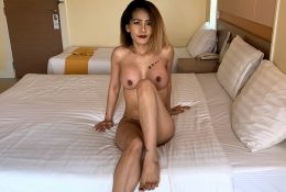 Tatted Thai babe with large pretend knockers and insatiable horniness