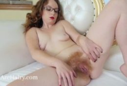 Ana Molly masturbates along with her glass dildo